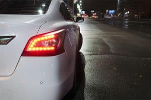 Nissan Altima at night with brake lights