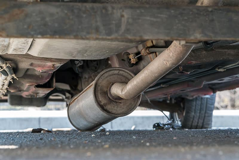 Old, damaged muffler that needs to be replaced