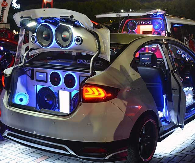 Many subwoofers in a car's trunk