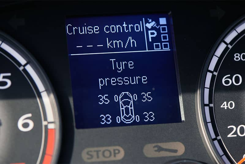 The dashboard display showing normal tire pressures on all four wheels.